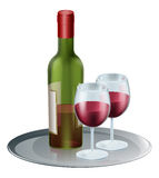 Red Wine Bottle and Glasses. Red wine bottle and wine glasses on a silver tray or platter Royalty Free Stock Photos