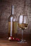 Red Wine bottle and glasses. Standing on reflective table on black background Royalty Free Stock Photo