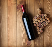Red wine bottle and grape shaped corks Stock Images