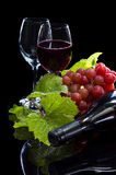 Red wine bottle, grapes and full glass Royalty Free Stock Photo