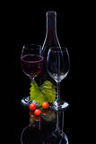 Red wine bottle, grapes and full glass Stock Photos