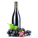 Red wine bottle and grapes. Royalty Free Stock Images