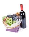 Red wine bottle and grapes Stock Photos