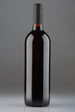 Red wine bottle on gray background Royalty Free Stock Images