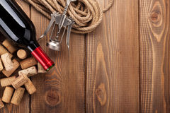 Red wine bottle, heap of corks and corkscrew Royalty Free Stock Photography