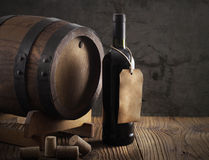 Red wine bottle and old barrel Stock Image
