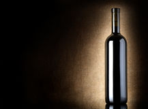 Red wine bottle on a old canvas Stock Photo