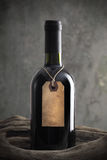 Red wine bottle with old paper label Royalty Free Stock Photos
