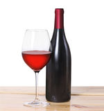 Red wine bottle, one glass Stock Photos