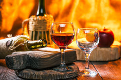 Red wine in bottle in one wineglass Royalty Free Stock Photography