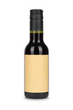 Red wine bottle, with paper blank label isolated on white Royalty Free Stock Photo