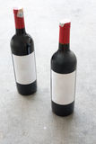 Red wine bottle, with real paper blank label Stock Photos