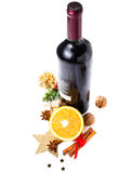 Red wine bottle and spices for Christmas Hot Mulled Wine on whit Royalty Free Stock Photography