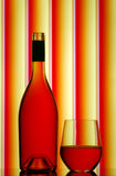 Red wine bottle & stemless glass. Bottle of red wine and stemless glass with elegant stripe background royalty free stock images