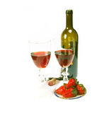Red wine bottle and two glasses with strawberries Royalty Free Stock Images