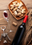 Red wine bottle, wine glass, bowl with corks and corkscrew Stock Photo