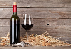 Red wine bottle and wine glass Stock Photo