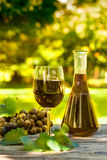 Red wine bottle and wine glass. On wooden table Stock Image