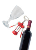 Red wine bottle, wineglass and corkscrew on white Royalty Free Stock Photography