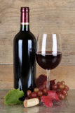 Red wine in a bottle and wineglass Stock Photos