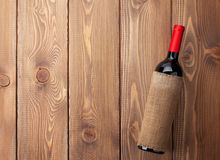 Red wine bottle on wooden table Stock Photos