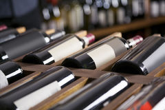 Red Wine Bottles Displayed On Shelves Stock Images