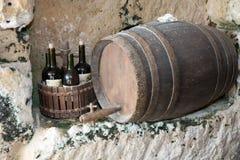 Red wine, bottles, old barrel Royalty Free Stock Image