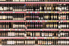 Red Wine Bottles On Supermarket Stand Stock Image