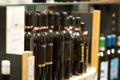 Red wine bottles in winery store. Rome, Italy - December 22, 2017: Red wine bottles on winery supermarket shelf. Selective focus. Eataly is the Italian upscale Stock Photos