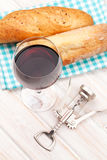 Red wine, bread and corkscrew Royalty Free Stock Images