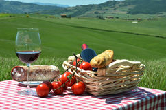 Red wine, bread, sausage and tomatoes Stock Photo