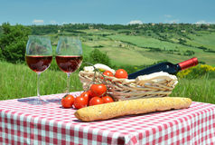 Red wine, bread and tomatos Stock Images