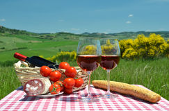 Red wine, bread and tomatos Stock Photo