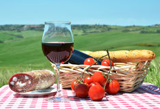 Red wine, bread and tomatos Stock Photography