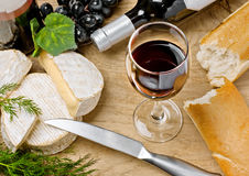 Red wine, Brie, Camembert, bread and grape Royalty Free Stock Photo