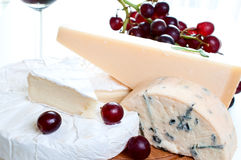 Red wine and brie parmesan and blue cheese Royalty Free Stock Images