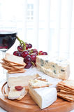 Red wine and brie parmesan and blue cheese Stock Images