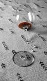 Red wine in broken glass Stock Photos