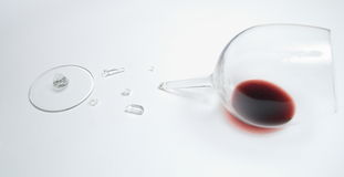 Red wine in broken glass Royalty Free Stock Photo