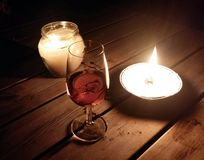 Red wine and candle Stock Photos