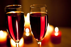 Red wine and candles Stock Images