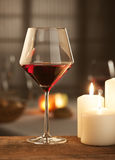 Red wine with candles Stock Photo
