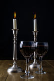 Red Wine with candles on wood table stock photography