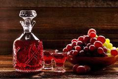 Red wine carafe and wine glass on wooden vintage background Royalty Free Stock Image