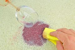 Red Wine on a Carpet Stock Photo