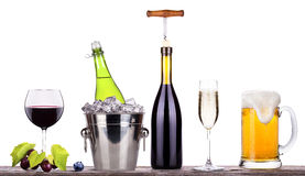 Red wine, champagne, beer with summer fruits. Red wine, champagne,beer with corkscrew,grape,Blue berrie, on a vintage wooden table isolated over white background stock photos
