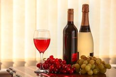 Red wine, champagne and grapes. Stock Photos