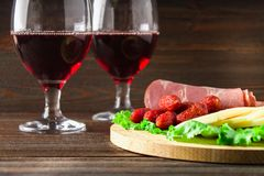 Red wine with charcuterie assortment on the background. royalty free stock image