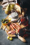 Red wine with charcuterie assortment on the stone background stock photos