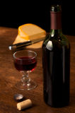 Red wine and cheese. On a wooden table Stock Photography